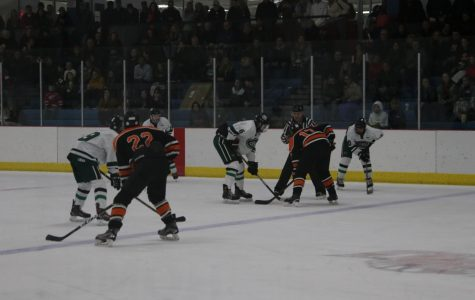 Mason Kelly's five goals leads hockey to two high-scoring conference wins over East Kentwood and Lowell/Caledonia