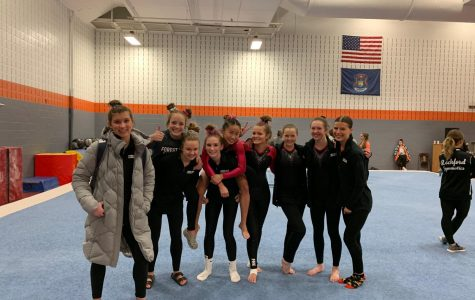 Varsity gymnastics performs well at first non-conference meet