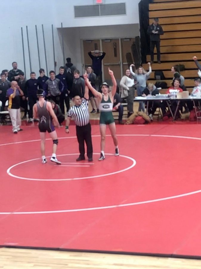 Robby Frazer wins clutch match to give varsity wrestling wins over both Caledonia and East Kentwood
