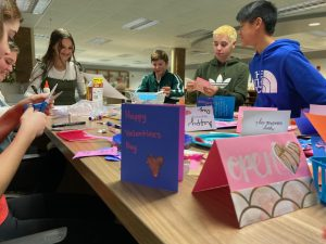 Valentine's Day activities within the library have long-term effects on the outside world