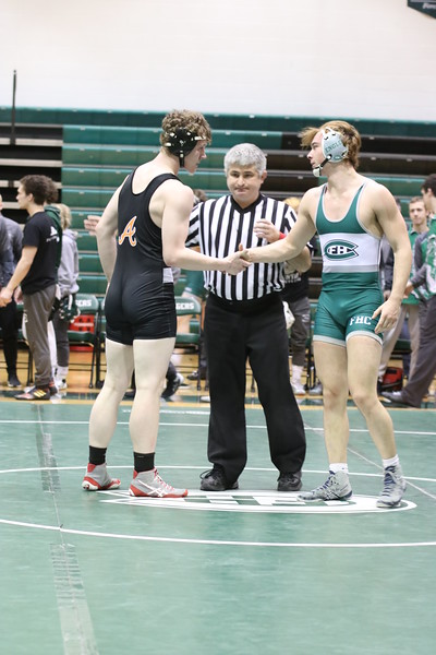 Boys varsity wrestling defeats Forest Hills Northern via a sixth criteria tie-breaker
