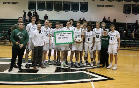 Jimmy Scholler reaches 1,000 career points as boys varsity basketball beats Grandville 67-52