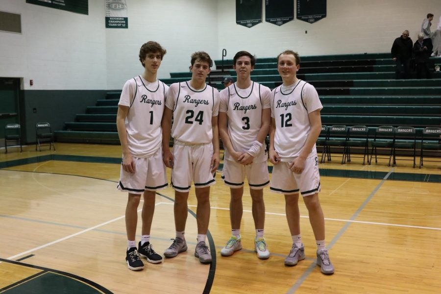 Boys varsity basketball drops regular season finale 53-48 to Unity Christian on Senior Night