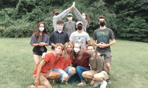 The Improv at the Park team wearing masks at one of their summer practices.