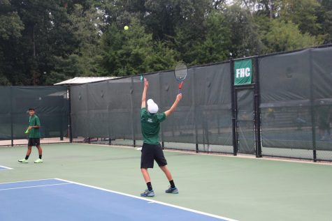 Boys varsity tennis singles players carry the Rangers to a 6-2 victory against East Grand Rapids