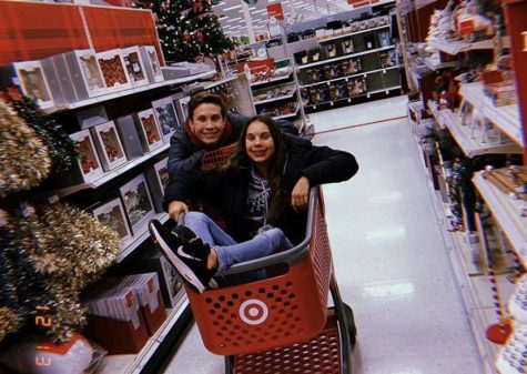 Ashley (in the cart) and her brother, Mason, inside a Target