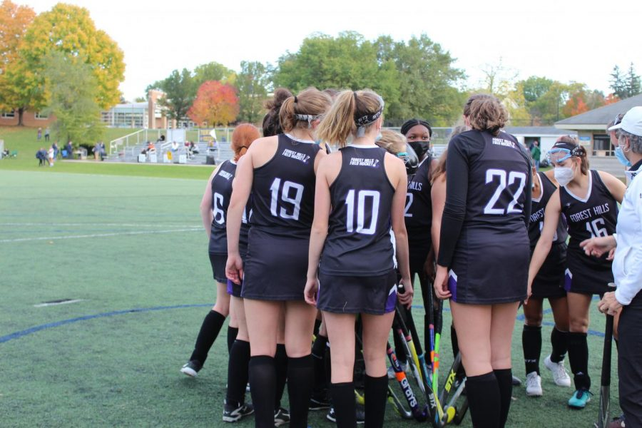 Varsity field hockey battles in a game that ends in a 2-2 tie against Novi