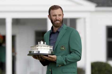 2020 Masters champion Dustin Johnson receives his long-awaited green jacket