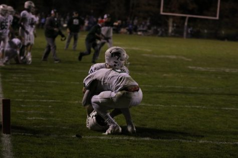 Junior Benny Scholler consoles senior Jonah Spates after the game is called.