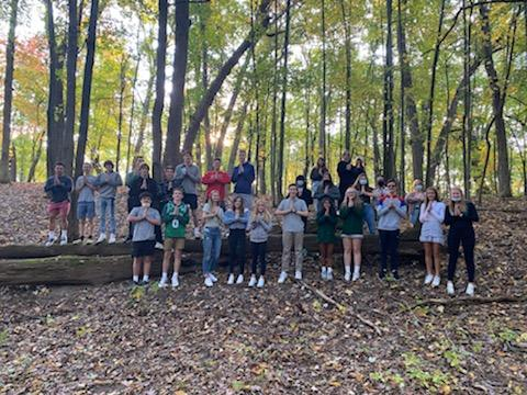 The class is outside on a nature walk