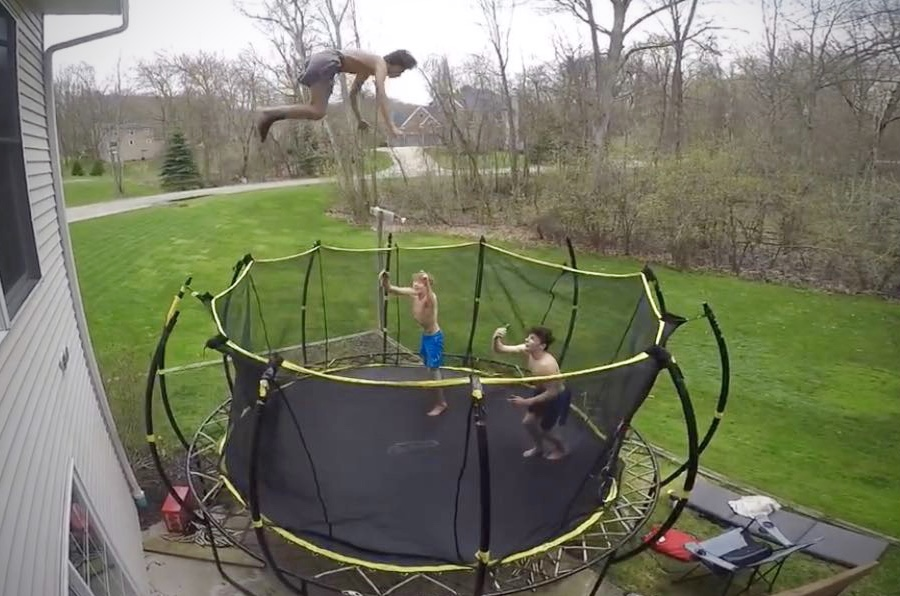 Evan Brown on the trampoline doing stunts with his friends.
