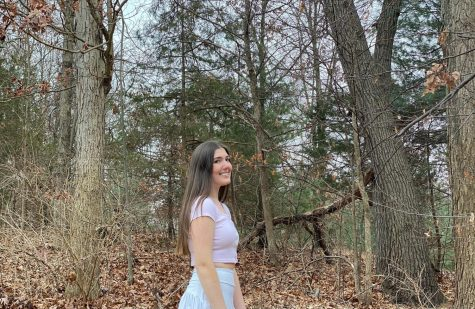 Natalie poses in the beautiful fall forest