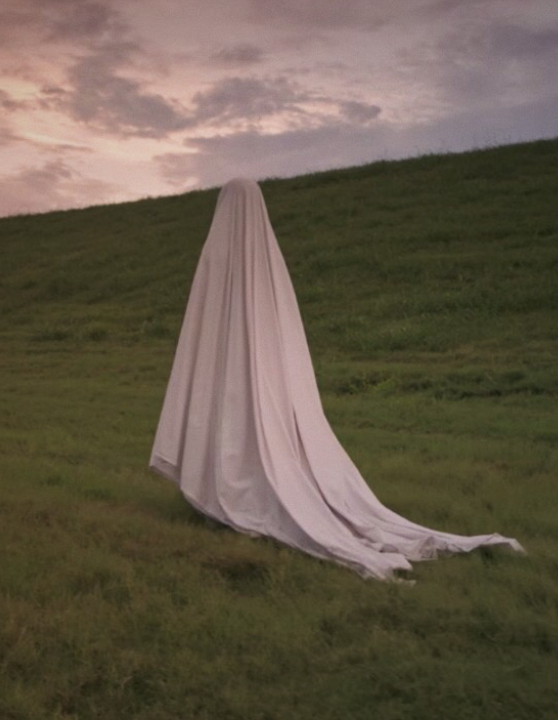 A ghost wandering in the hills like her, like the me wandering my own self inside.
