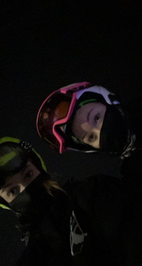 A picture of my friend and I waiting in line for the ski lift at practice.