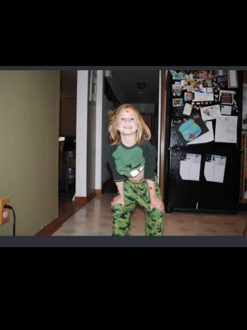 Me when I was younger in my dinosaur pajamas