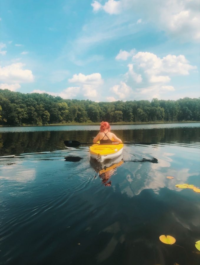 Me—in a kayak, risking my life by not wearing a life jacket, because I cannot, in fact, swim—living my teenage summer dreams and actually being happy for once.