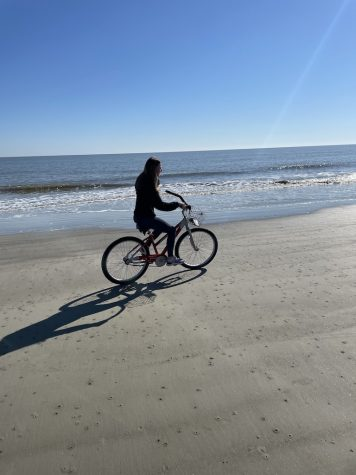 Me, giving off main character energy, at Hilton Head Island biking on the beach last month.