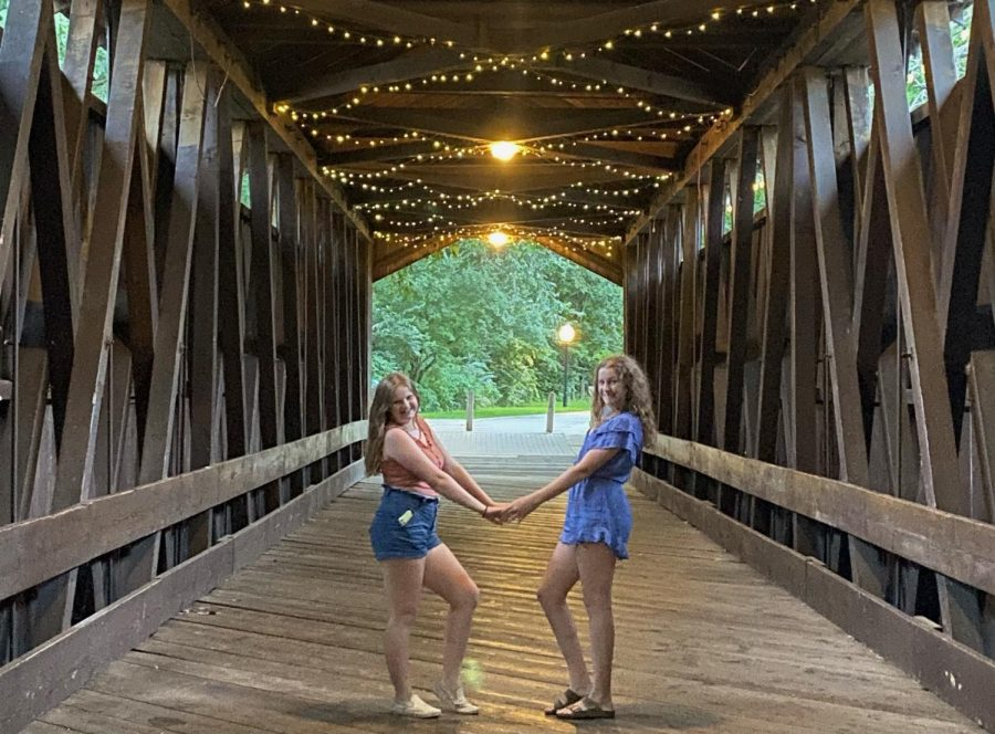 Freshman Addy Richards (right) and her friend Mia Young (left) posing on the Ada Covered Bridge
