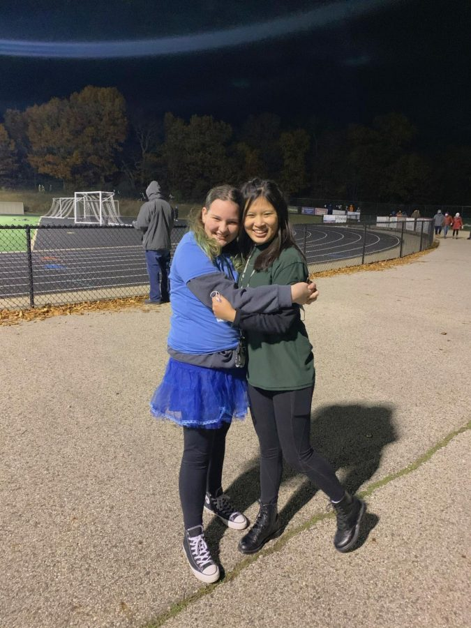 During one of the last football games of the season Ellie and I freeze together.