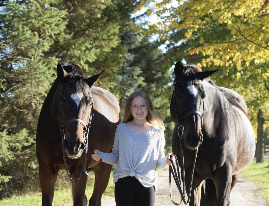 Emma poses with her two horses: Vinnie and Remi