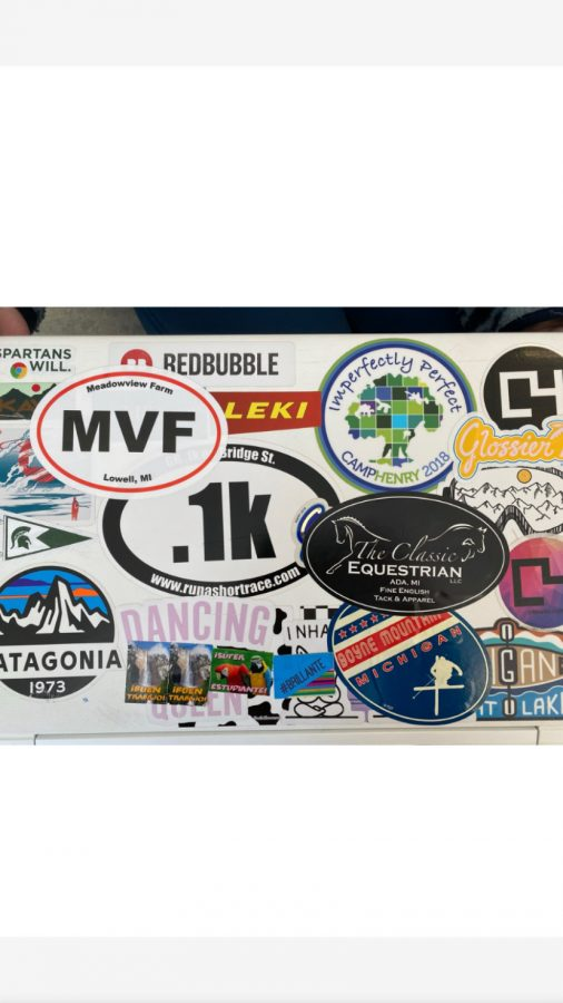 Katie Romijn decorates her laptop with a motley of stickers