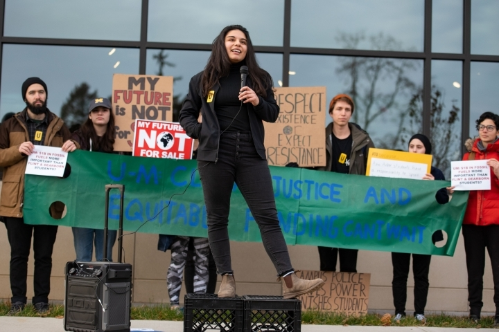 Amytess speaking at a protest that helped her get the scholarship