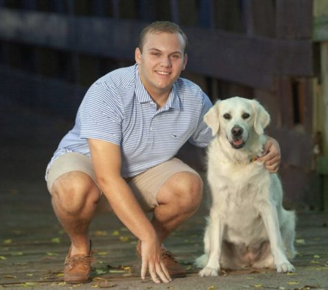 Sam Touri and his dog, Millie