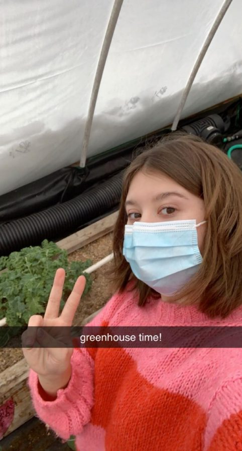 Bela Gonzalez in the greenhouse during her independent study