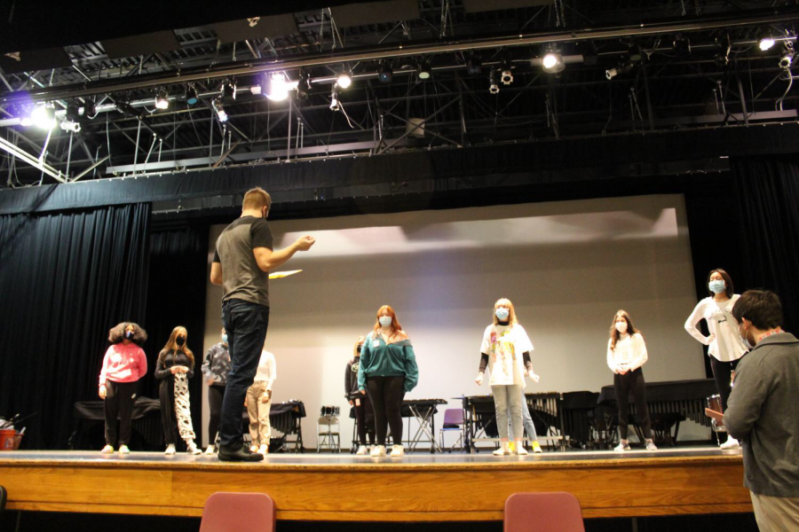 Two of the alumni teaching the students during musical auditions