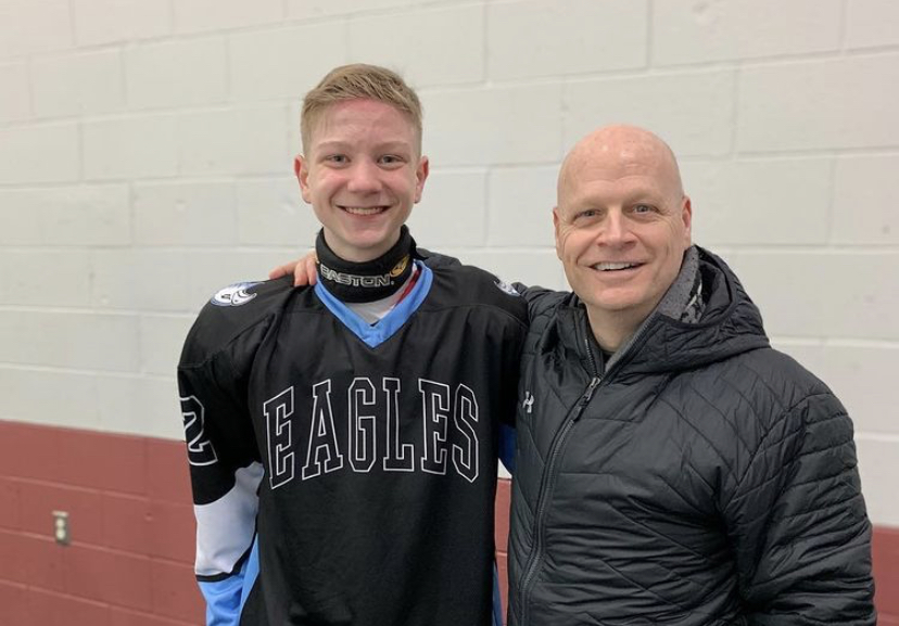 Dominic DeStefano at a hockey game with his father.