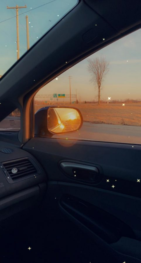 A Michigan spring sunset in my side mirror