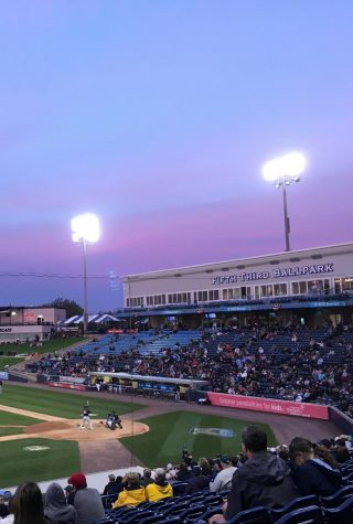 A sun setting at a baseball game last summer
