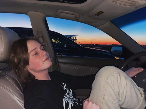 Joe chilling in his car as the sun sets