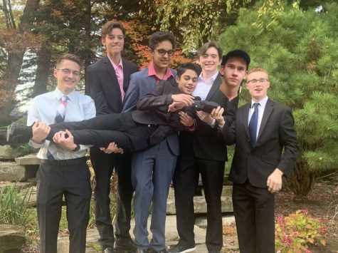 Daniel lying in the arms of his closest friends