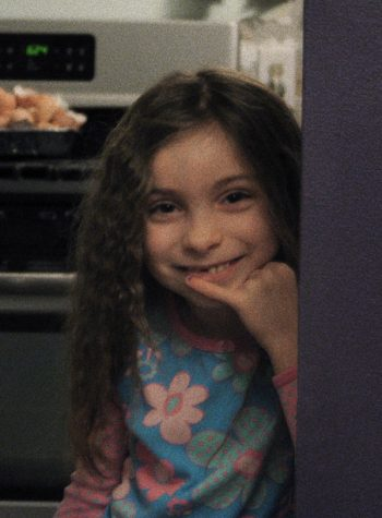 Here I am, on my seventh birthday, in the kitchen of my childhood home