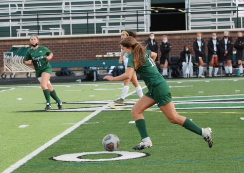 Freshman Gigi Sinicrope kicking the ball down the varsity field in hopes of another point for the Rangers.