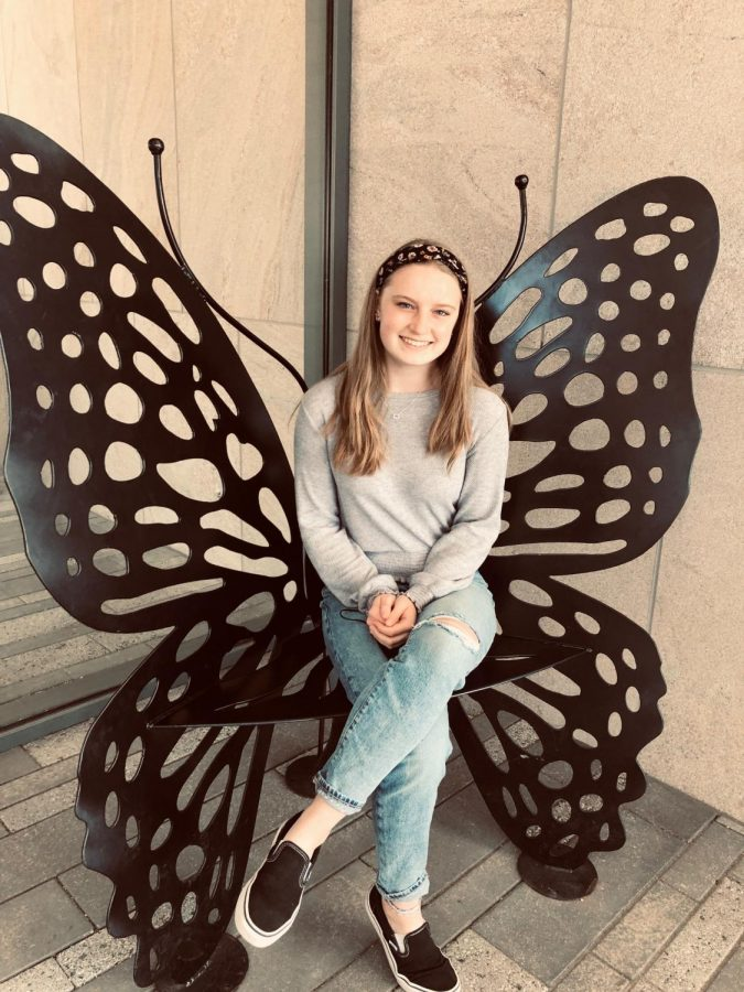 Me sitting on a butterfly seat at the Fredrick Meijer Gardens