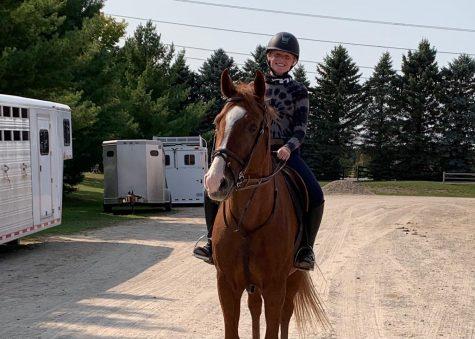 Katie Romijn on her horse, Malone.