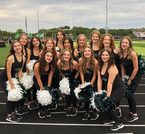 A photo captured by our coaches of us before performing our first Pre-Game of the season.