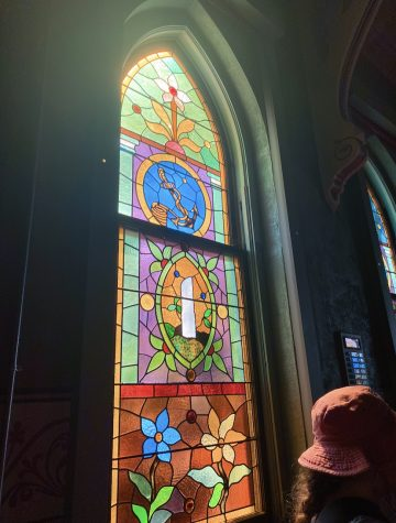 Sunlight coming through a stained glass window in a chapel in Charlevoix, feat Emmas bucket hat