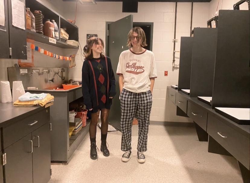 Seniors Katie Hoffman and Josh Treichel posing for a photo in the darkroom