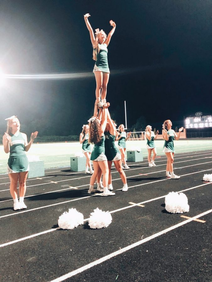 Me standing afloat on top of my bases at the Friday night football game.