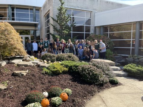 Honors English 10 students stand near their hard work in the FHC Memorial garden.