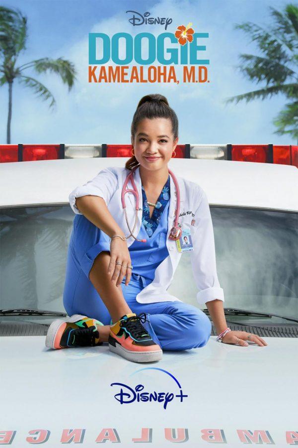 Lahela Doogie Kamealoha M.D. sits on an ambulance surrounded by the Hawaiian scenery.
