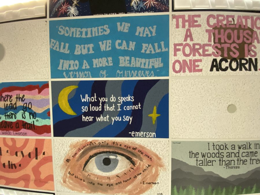 Some of the many ceiling tiles decorating Mr. Georges room, including Addis and Toris.