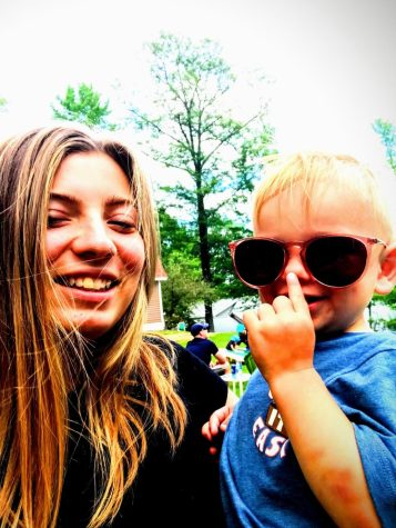 here is a picture of me and one of my little cousins over the summer