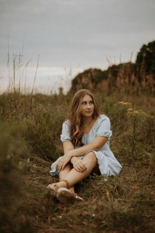 One of my many senior photos taken in the middle of a field right before it rained.