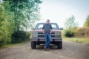 Senior Seth Bush posing in front of his pick-up truck