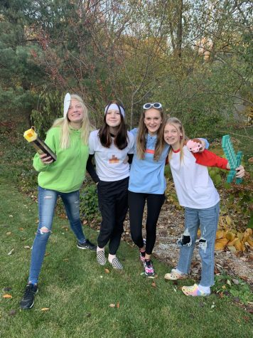 A picture of my friends and I trick-or-treating on the day of Halloween, which is a tradition that should not be changed.
