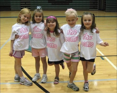 A Pom Clinic photo from years ago with coincidentally, two current team members (the two dancers on the far right).